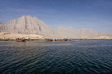 Oman, dhow boats in fjords mountain, sea view.