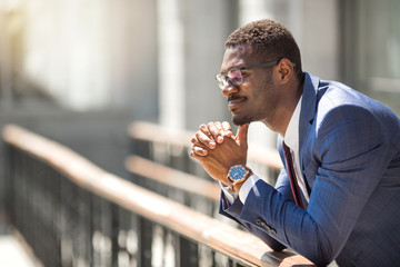 handsome young adult african man in suit and glasses