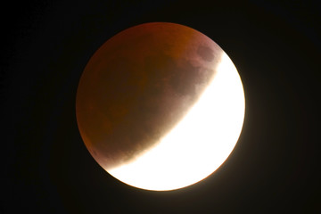 Lunar Eclipse July 2019, half phase on full Moon, taken in the deep space with the red shadow part.