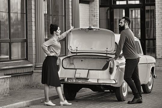 Couple in love near the car in retro style
