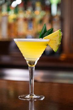 Pineapple Martini on Wood Bar Top