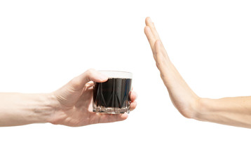 Say no cola. Man says no to soda. Hand gesture to reject proposal to drink soda. Hand holding a glass of cola to give and another hand rejects on a white background. Refuse, ban, rejection
