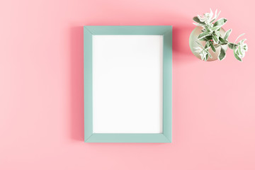 Beautiful flowers composition. Blank frame for text, flowers on pastel pink background. Flat lay, top view, copy space