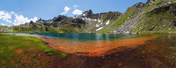 The Lac Bleu in Chianale, mountain lake in the italian alps of Cuneo, Piedmont.