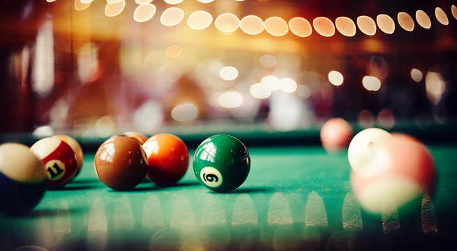 Colorful billiard balls on a billiard table.