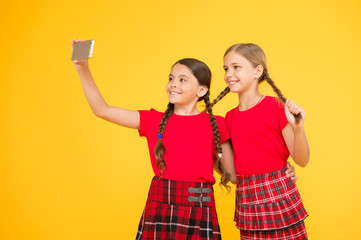 Born to be internet superstar. Girls take selfie smartphone. Take perfect photo. Girls just want to have fun. Schoolgirls use mobile phone smartphone taking photo. Selfie photo for social networks