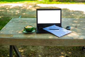 enjoy coffee relaxing and work on a laptop in balcony garden green trees background in the holiday