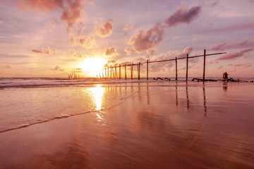 The old wooden bridge on the beach in sunset at Khao Pilai, Phangnga, Thailand.