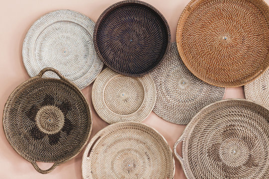 Wall decorated with different wicker handmade trays and baskets. Eco style and concept, Moroccan culture.