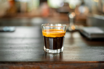 Black coffee in small shot .