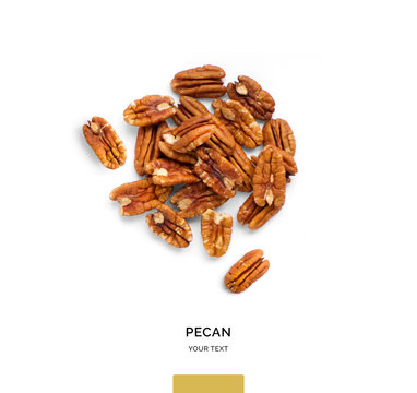 Creative layout made of pecan nuts on white background.Flat lay. Food concept.