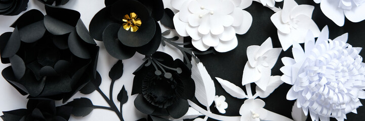 Black paper flowers on white background. Cut from paper.