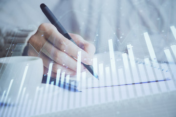 Forex chart displayed on woman's hand taking notes background. Concept of research. Double exposure