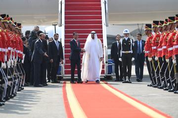 Abu Dhabi's Crown Prince Sheikh Mohammed bin Zayed Al Nahyan shakes hands with Indonesia's President Joko Widodo as he arrives at Soekarno Hatta International airport near Jakarta