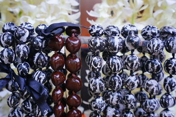 Kukui nut lei necklaces awaiting visitors in Hawaii