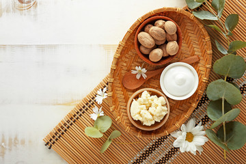 Composition with shea butter on table
