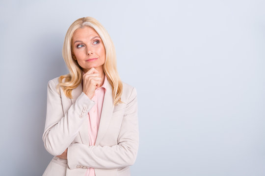 Portrait of her she nice attractive charming stylish minded focused wavy-haired lady executive director creating new plan agenda touching chin isolated over light white gray pastel background