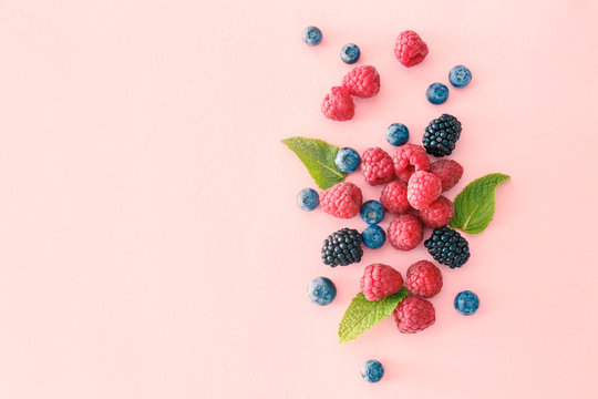 Sweet ripe berries on color background
