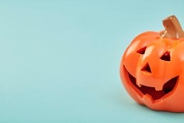 One Halloween Pumpkin on pastel blue background