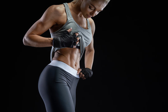 Close-up photo of healthy fit young woman strong abs