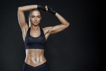 Smiling fitness young woman with a healthy toned body