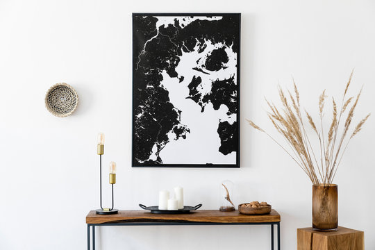 Stylish and cozy scandinavian interior of living room with wooden console, ring on the wall, cube, flowers and elegant personal accessories. Black mock up poster map. Design home decor. Template.