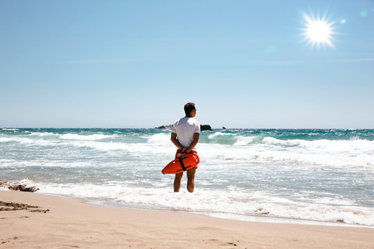 A lifeguard boy on the beach in a summer sunny day