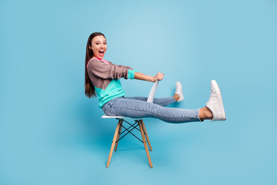 Full length photo of amazed rejoicing glad positive nice creative teen girl imaging she ridding a horse or bicycle isolated bright background