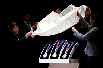 Design of the Tokyo 2020 Olympic medals are unveiled during the 'One Year to Go' ceremony celebrating one year out from the start of the summer games at Tokyo International Forum in Tokyo
