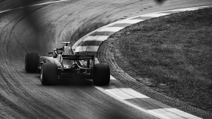 F1 race car on the road, driving into the corner
