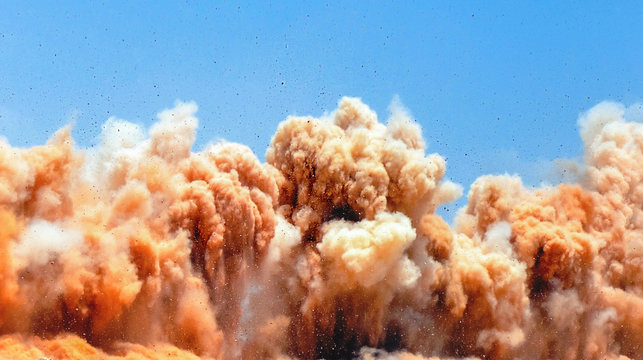 Dust clouds and rock particle after the detonator blast on the construction site