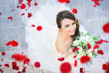 bride in rose petals like a fairy tale