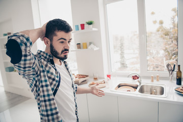 Profile side view portrait of his he nice attractive frustrated bearded guy unsure mess chaos decide in modern light white interior style kitchen Wall mural