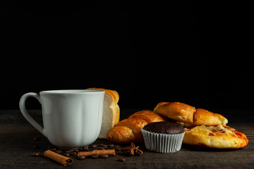 cup of coffee bread on wooden table.