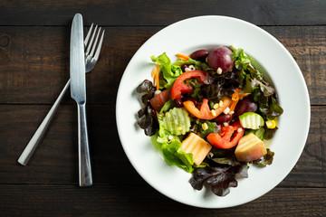 fresh vegetable salad on wooden.