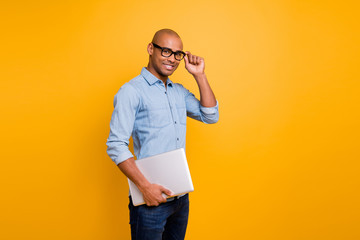 Photo of dark skin guy notebook hands classroom young school teacher wear specs jeans denim shirt isolated bright yellow background