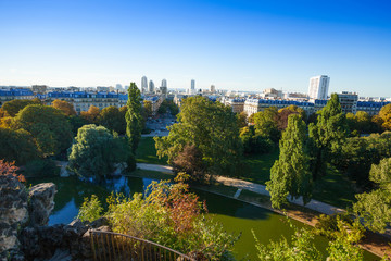 Fototapete - Beautiful cityscape from Buttes Chaumont park