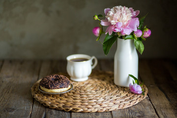 Donuts with fragrant tea. Bakery products. Peonies