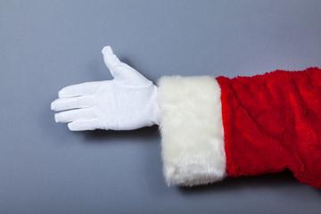 Weihnachtsmann gibt Hand