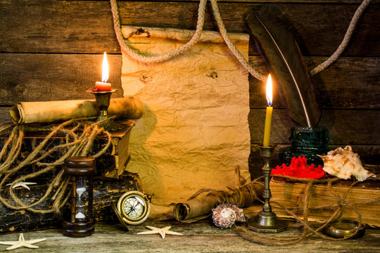 Collection of antique items on the theme of adventure on a wooden background. Space for text.