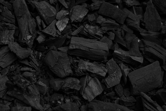 Black charcoal pieces texture background for barbeque