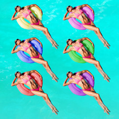 Women with different color buoys swim in the pool