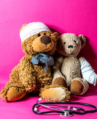 concept of child friendship at hospital with ill teddy bears