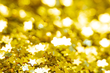 Gold glitter stars texture. Festive sparkling sequins background. Wpaper for Valentine, New Year or...