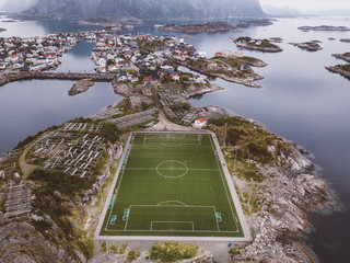 Aerial view of soccer field and city located in island