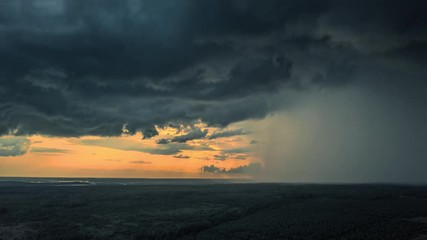 Fotobehang - Aerial view of storm clouds coming over with heavy rain falling down. Hyperlapse timelapse, 4K UHD.