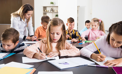 Little children with teacher in classroom