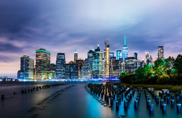 Manhattan panoramic skyline at night from Brooklyn Bridge Park. New York City, USA. Office buildings and skyscrapers at Lower Manhattan (Downtown Manhattan)..