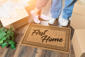 Man and Woman Unpacking Near First Home Welcome Mat, Moving Boxes and Plant