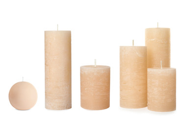 Set with wax candles on white background
